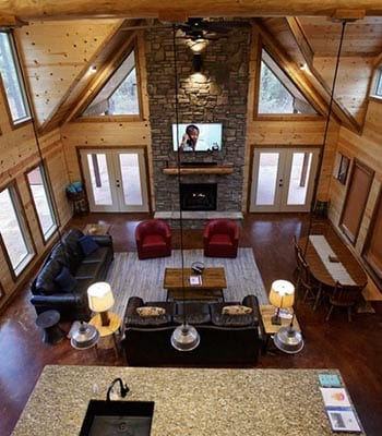 loft view of living room and fireplace.