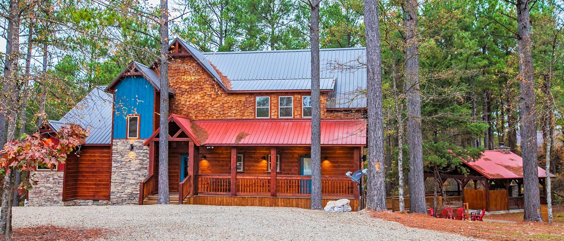 home exterior in woods.