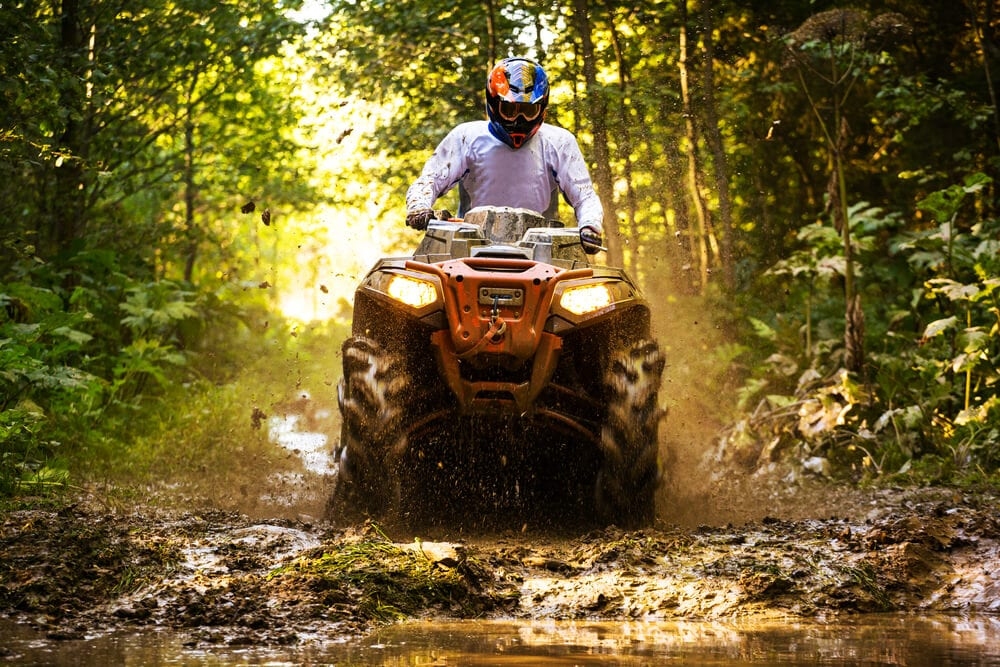 Photo of an ATV Rider on One of the Muddiest Broken Bow ATV Trails.